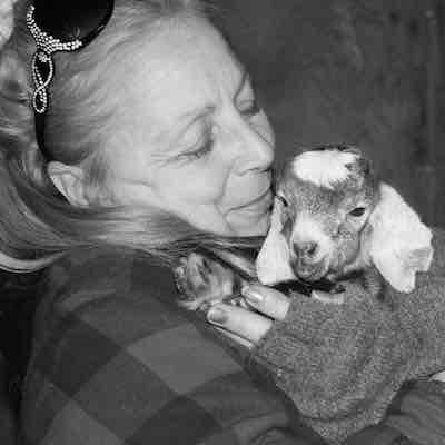 Writer Dovely holding her baby goat