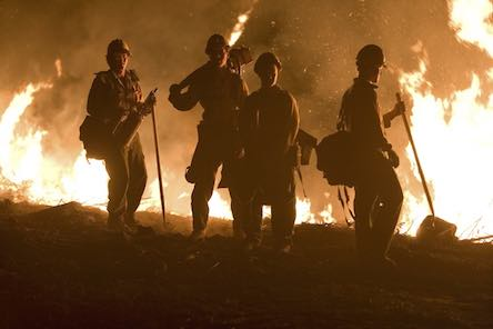 Firemen battle buringing cannabis planatons