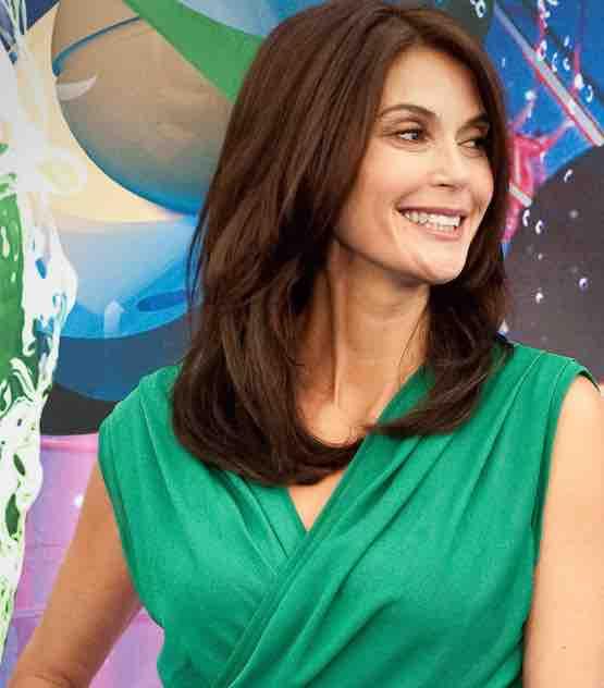Houswives star publicity still  in Green dress
